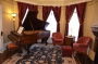 Main parlor with Knabe Piano and gas fireplace